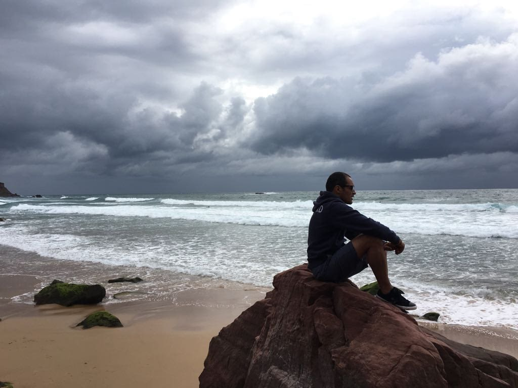 Phil on stormy beach in Portugal