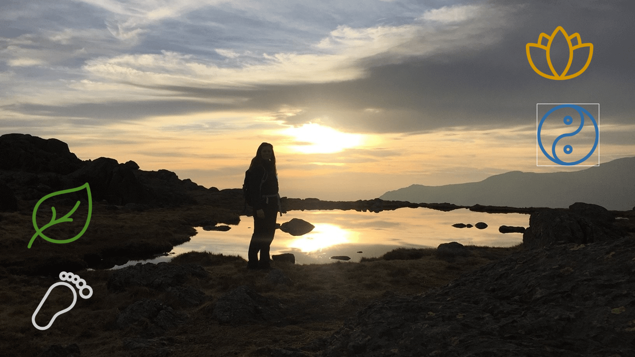 Woman standing with good posture in front of lake