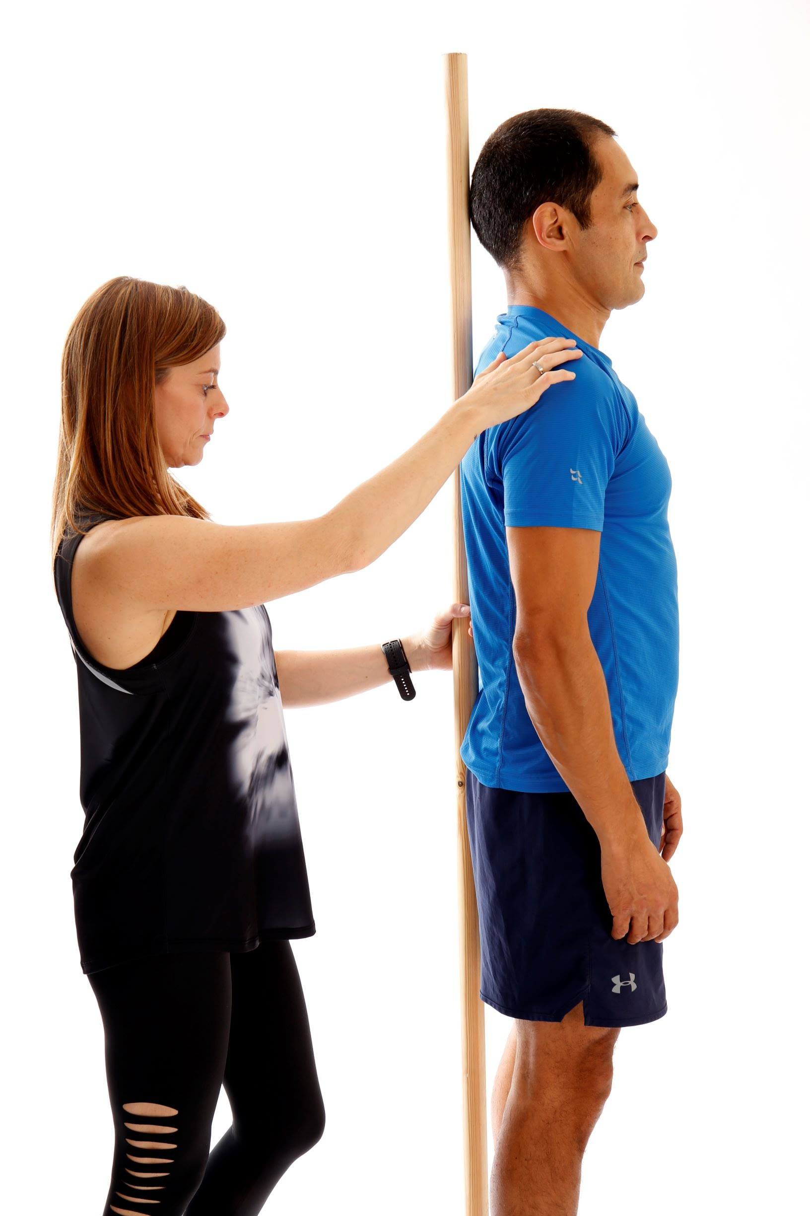 health coach assisting client with posture correction